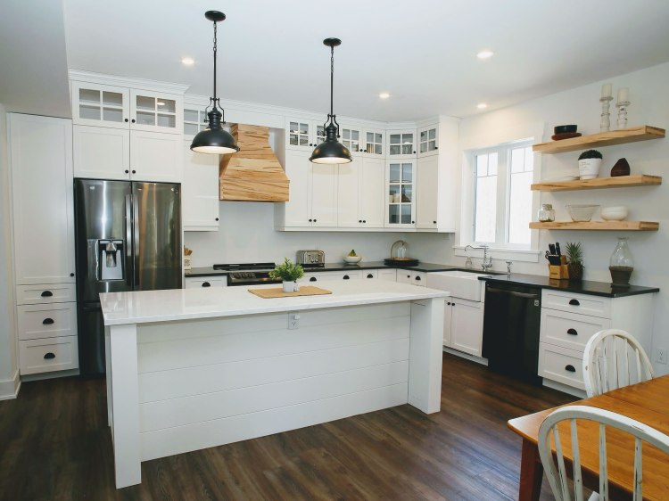 White kitchen with black and natural accents