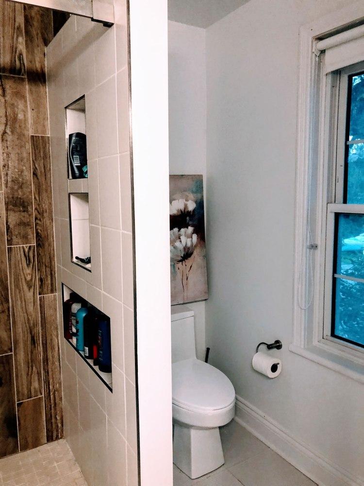 Custom shower with toilet tucked around the corner