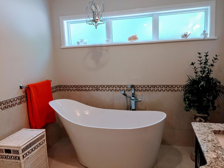 Slipper bath in large bathroom renovation