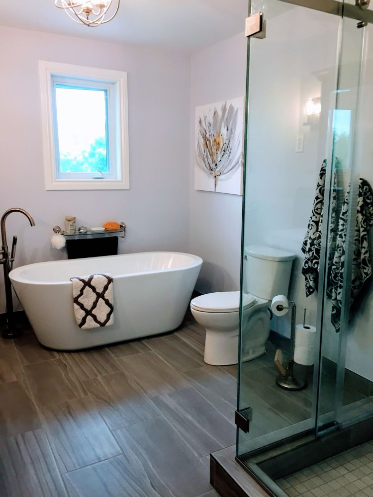 Modern stand alone tub in large bathroom