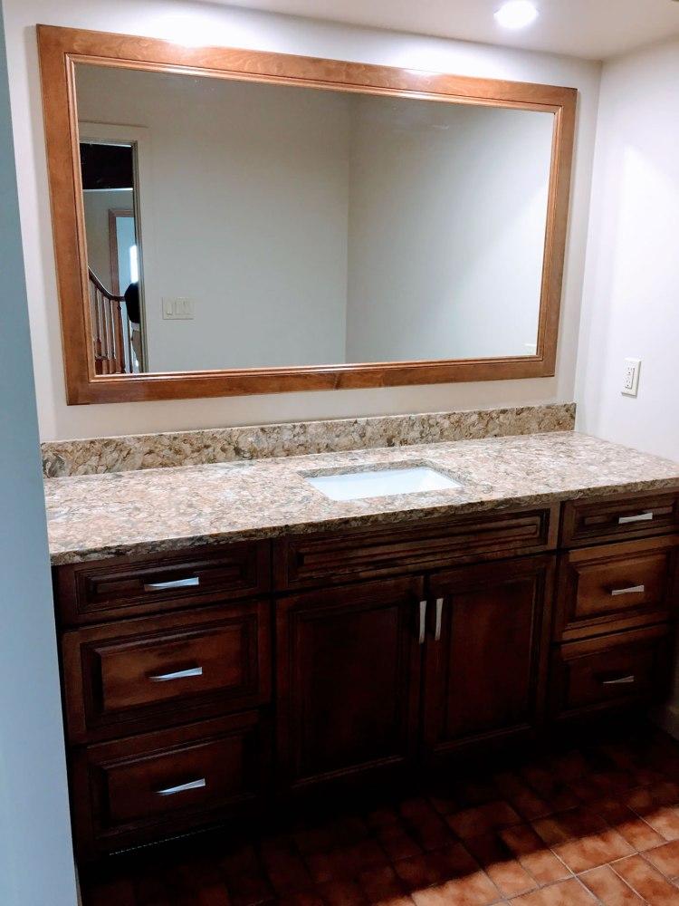 Dark custom bathroom cabinetry