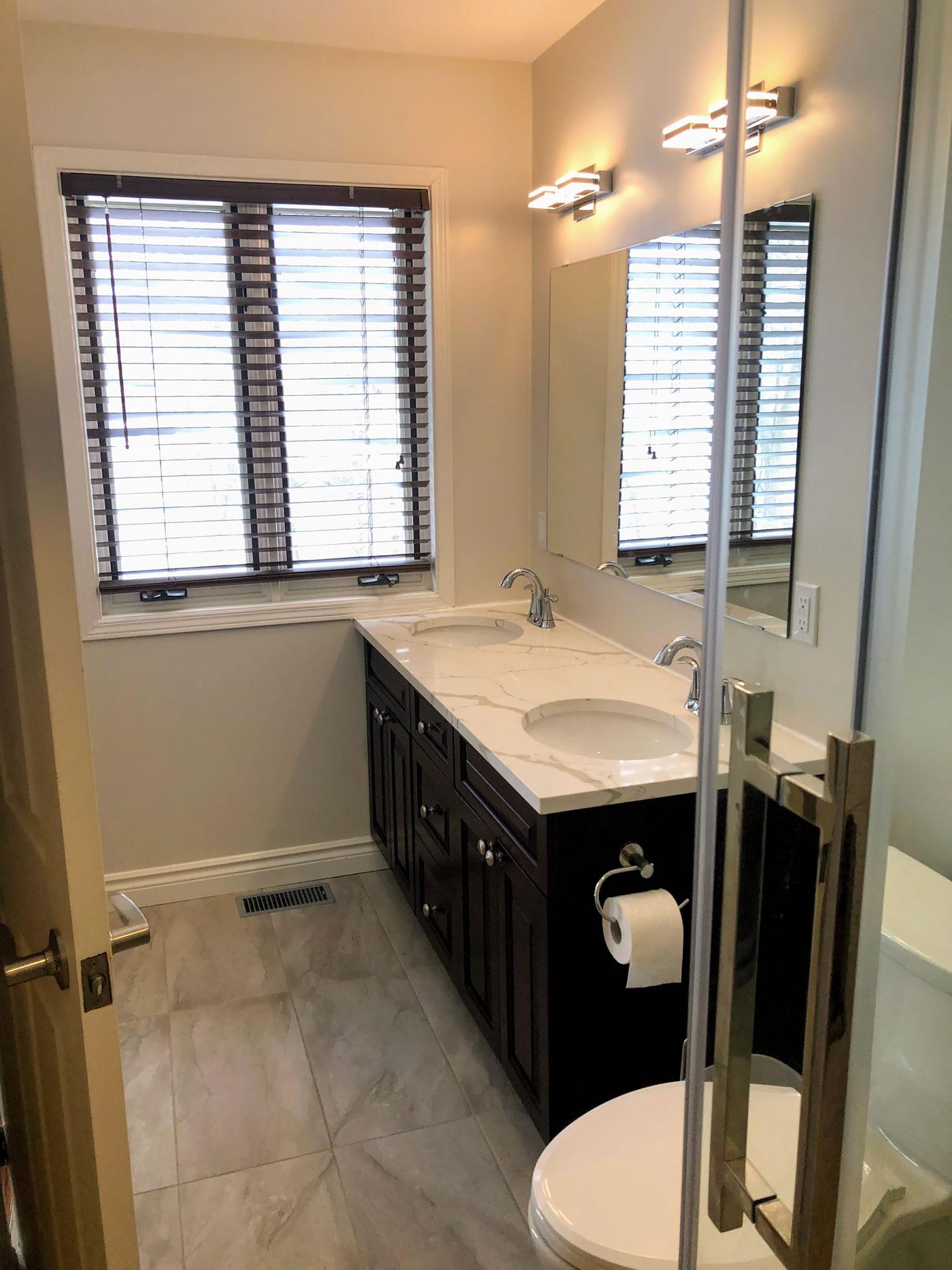Traditional bathroom cabinetry in dark tones