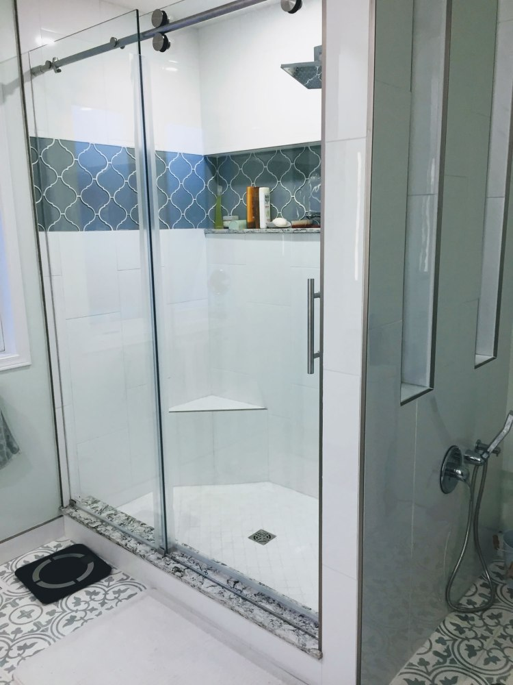Tiled shower with glass doors