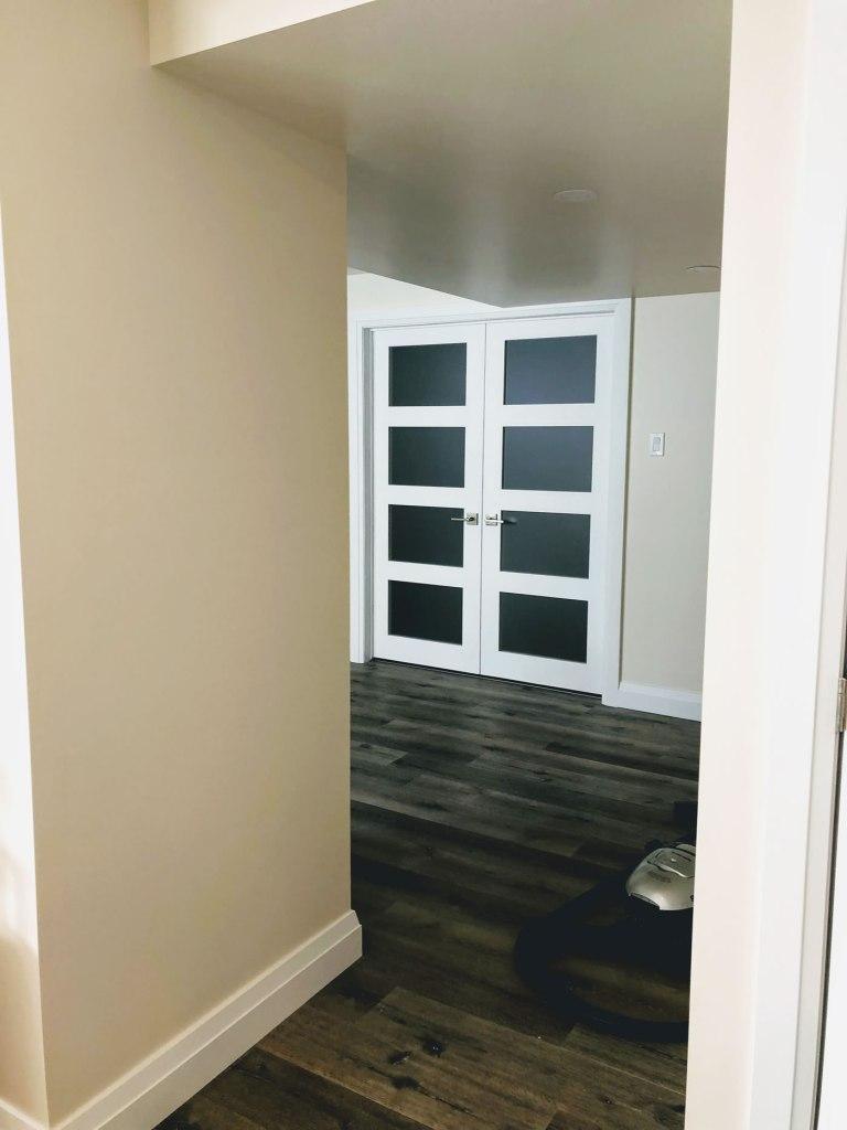 Double doors in renovated basement
