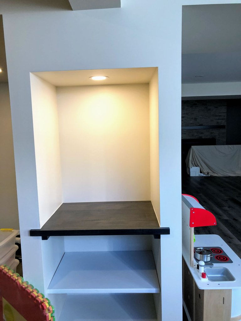 Shelving unit with inset light