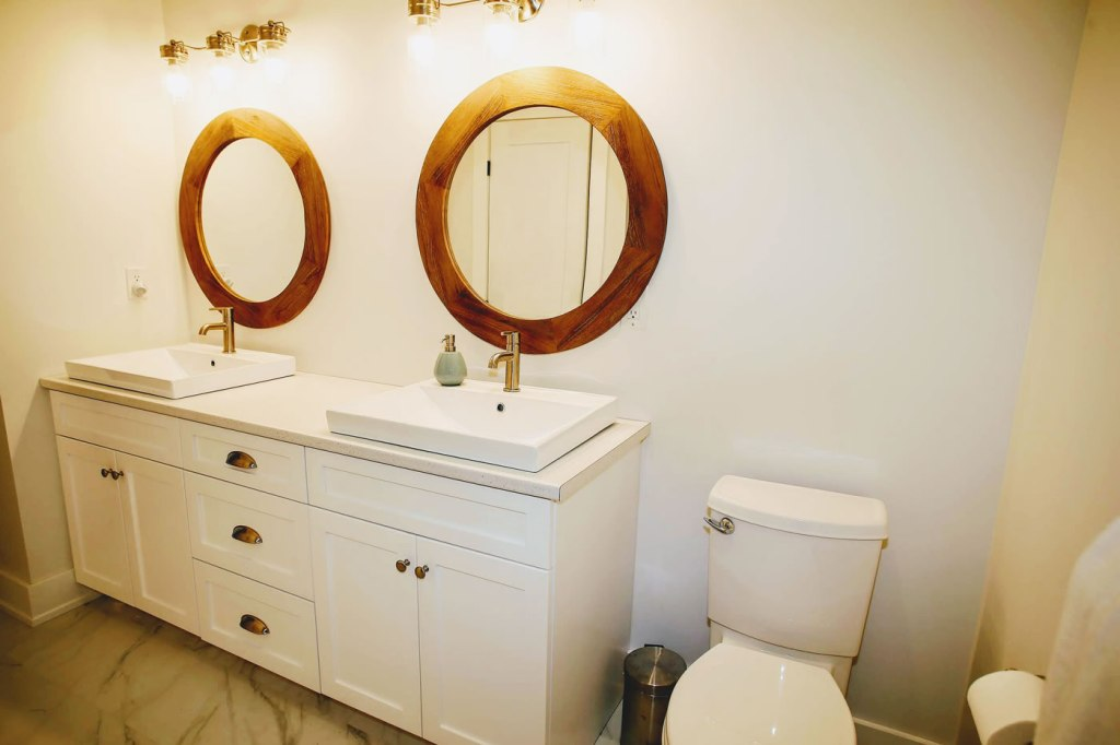 Bathroom with round wood mirrors