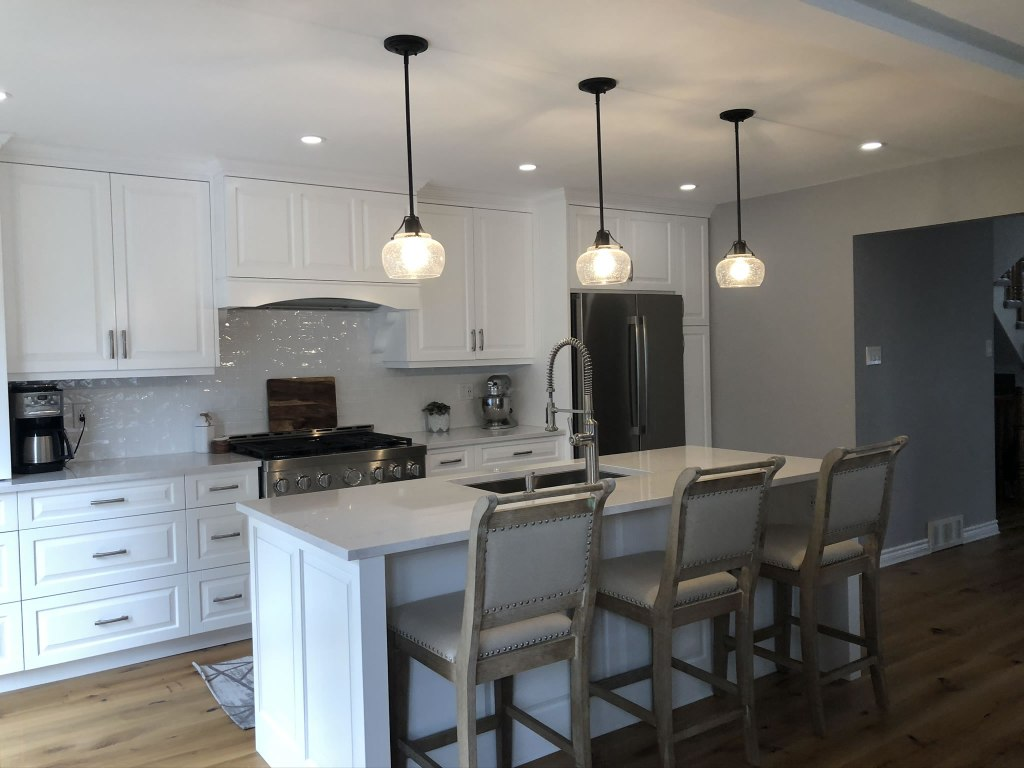 Custom kitchen, all white, pendant lights, island with upholstered stools